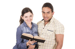 Couple of cheerful happy attractive students holding book Stock Photography
