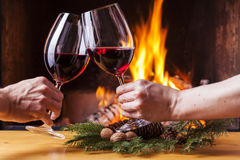 Couple cheering with red wine christmas decoration Royalty Free Stock Image