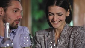 Couple cheering with white wine glasses on romantic dinner. At restaurant closeup stock video