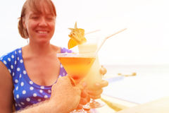Couple cheers at tropical beach Stock Images