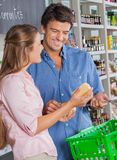 Couple With Cheese Shopping In Grocery Store Stock Photography