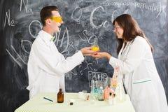 Couple chemists enjoy of chemistry experiment Stock Photo