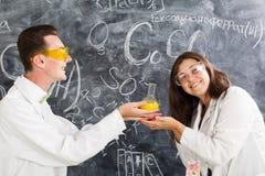 Couple chemists enjoy of chemistry experiment Stock Images