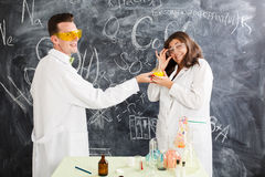 Couple chemists enjoy of chemistry experiment Royalty Free Stock Images