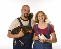 Couple with chickens Stock Image