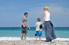 Couple with child on the beach Stock Photos