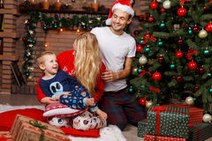 Couple ,child in Christmas interior Stock Image