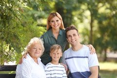 Couple with child and elderly woman stock images