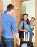 Couple with child leaving home Stock Images