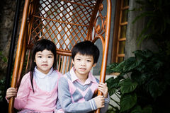 Couple of children. A couple of children sitting on the rocking chair Stock Photography