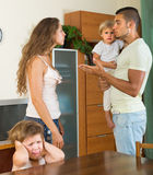 Couple with children having quarrel. Married couple with two little children having conflict at home Stock Image