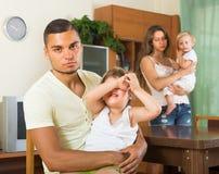 Couple with children having quarrel. Couple with two little children having quarrel at home Stock Photos