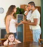 Couple with children having quarrel Stock Photos