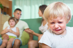 Couple with children having quarrel. Young married couple with two little daughters having quarrel at home Stock Photo