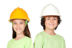Couple of children with helmet Stock Images
