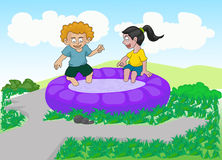 Couple children playing water Stock Images