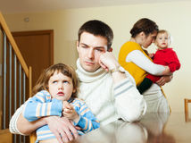 Couple with children in quarrel Royalty Free Stock Image