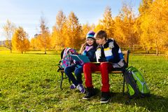 Couple children after school Stock Images