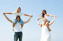 Couple with children on the shoulders Stock Photo