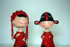 Couple. Chinese bride and bridegroom in traditional wedding clothes Royalty Free Stock Images