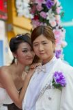 Couple Chinese girls posing. Young couple Chinese girls posing in a wedding dress Royalty Free Stock Photos