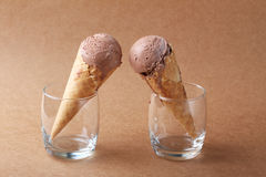 Couple of chocolate flavor ice cream cones in a glass on matte b Stock Images