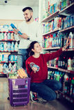 Couple choose some detergents Stock Photography