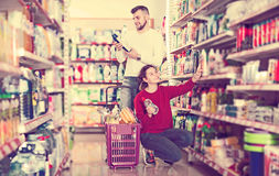 Couple choose some detergents. Glad couple choose some detergents in the shop Stock Image