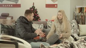 The couple chooses furniture stock video footage