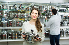 Couple chooses pans in shop cookware Royalty Free Stock Images