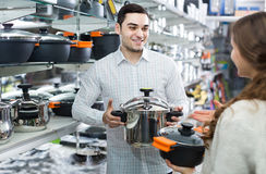 Couple chooses pans in shop cookware Stock Image
