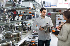Couple chooses pans in shop cookware Stock Photo