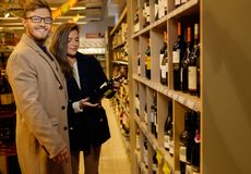 Couple choosing alcohol Stock Photo