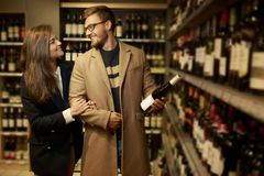 Couple choosing alcohol Royalty Free Stock Photography