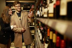 Couple choosing alcohol Stock Images