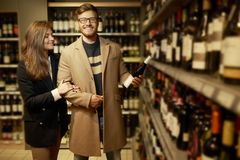Couple choosing alcohol Royalty Free Stock Images