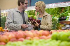 Couple choosing apples in grocery store Stock Photo