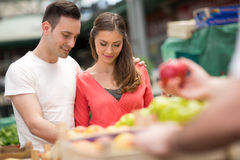 Couple choosing apples in grocery store Royalty Free Stock Images