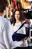Couple choosing bags in shop Stock Image