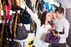 Couple choosing bags in shop Stock Photography