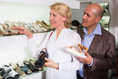 Couple choosing casual shoes Stock Image