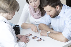 Couple choosing characteristic of their child Stock Photo