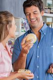 Couple Choosing Cheese At Grocery Store Royalty Free Stock Photo