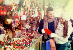 Couple choosing Christmas decoration Royalty Free Stock Photography