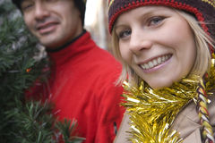Couple choosing Christmas tree Stock Photos