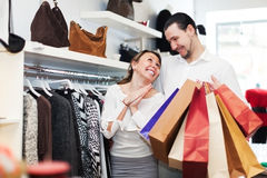 Couple choosing clothes at fashion market Royalty Free Stock Photo