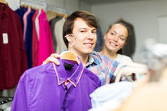 Couple choosing clothes in the mall Royalty Free Stock Photo