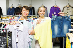 Couple choosing clothes in the mall Stock Photography