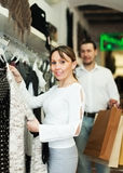 Couple choosing clothes at market Royalty Free Stock Photography
