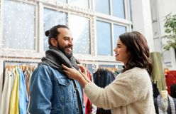 Couple choosing clothes at vintage clothing store Stock Photos